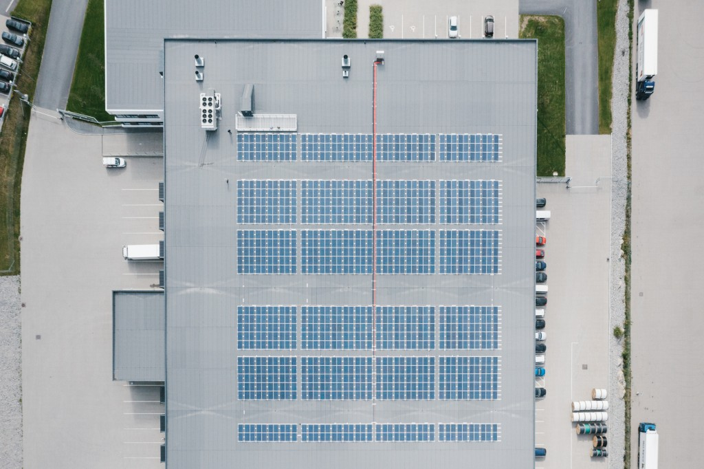 Birds eye view of warehouse with solar panels on roof