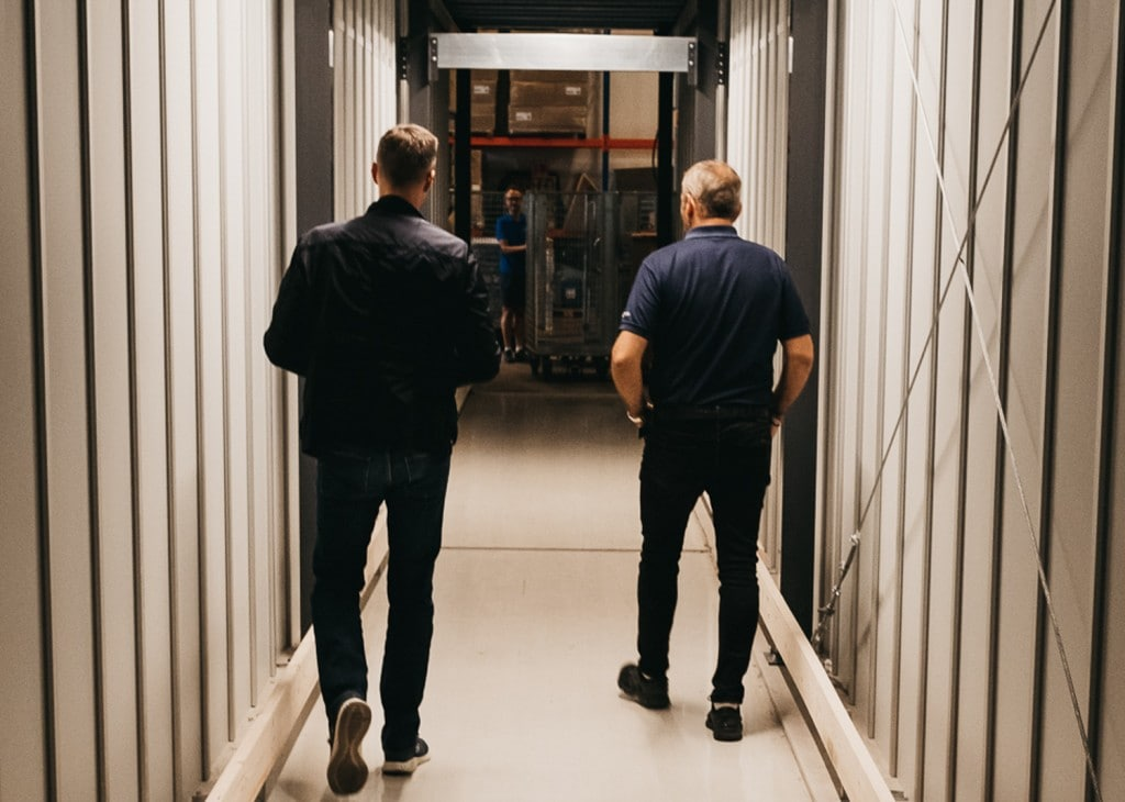 Founder, Trond Gule, and Element Logic Sales Manager, Øyvind Kollerud, walking through the custom-made tunnel through AutoStore in GS Bildeler Oslo warehouse